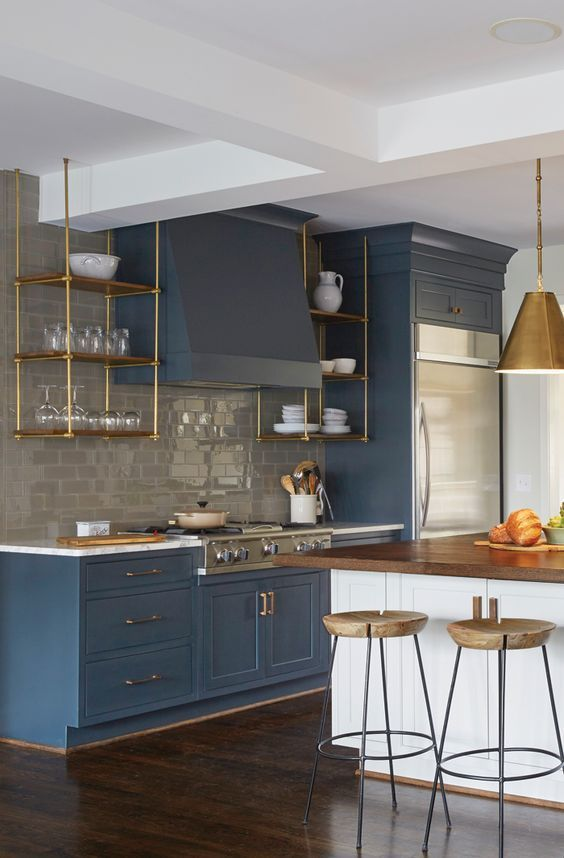 a cute navy kitchen design with white walls