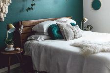 a small yet stylish green bedroom design