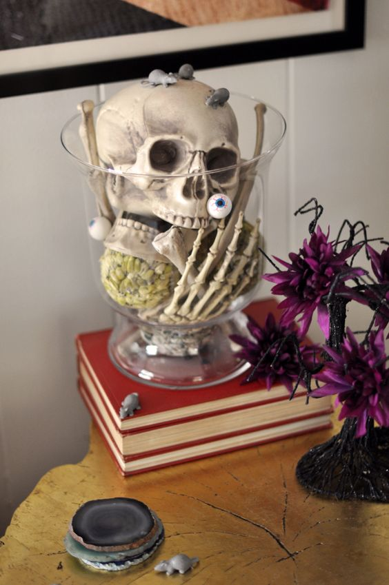 a clear bowl with a skull, skeleton hands, eyeballs and mice is a very easy last-minute Halloween decoration or centerpiece
