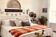a cozy bedroom with DIY fabric pumpkins