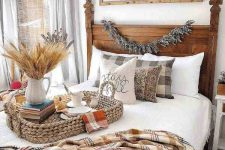 a cozy bedroom with a DIY fall sign