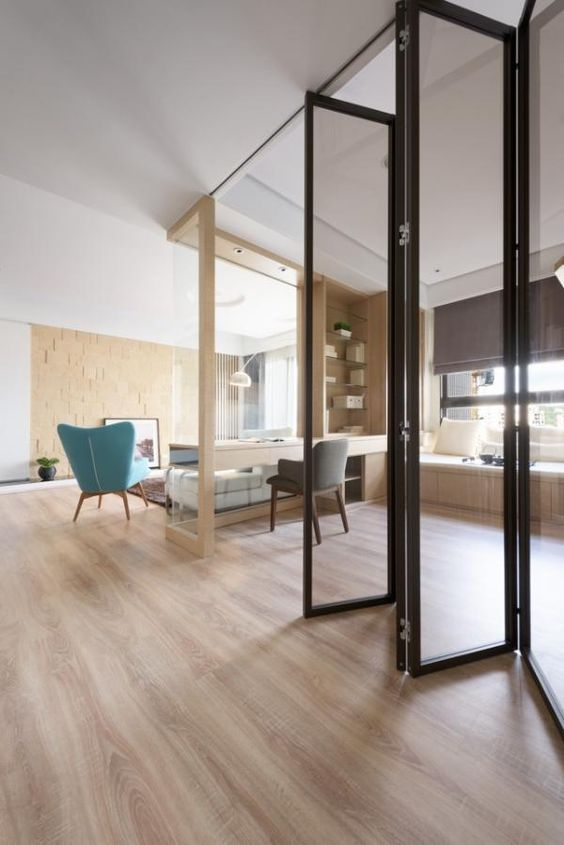 a creative black frame and smoke glass folding door is a gorgeous way to zone the spaces creating a separate home office
