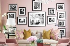 a cute pink living room with b&w gallery wall