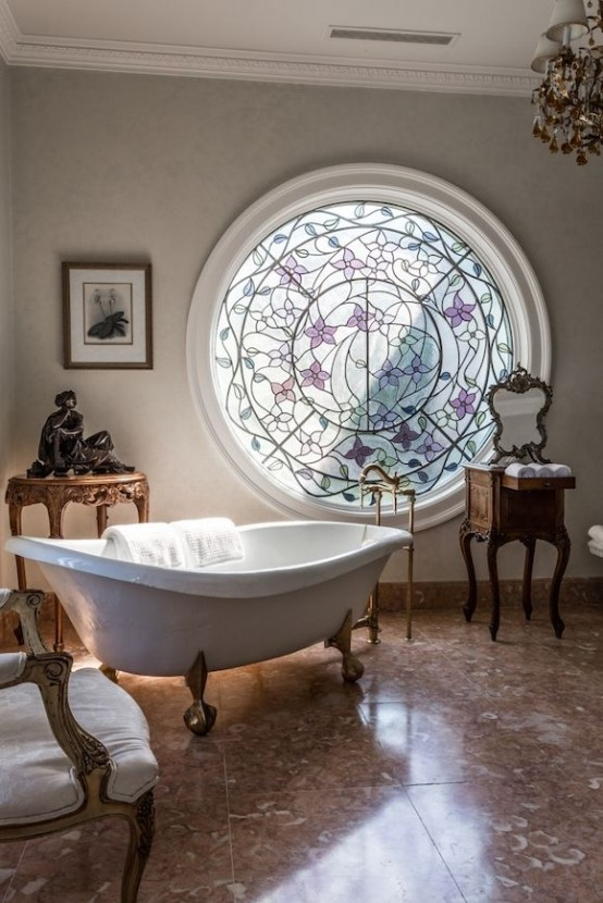 a fantastic vintage bathroom with a round stained glass window, some refined vintage furniture and an artwork is a gorgeous idea to go for
