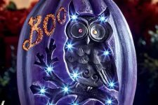 a jaw-dropping purple Halloween pumpkin with lights and an owl plus BOO letters is a great decoration