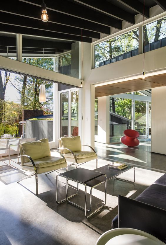 a light-filled mid-century modern space with glazed walls and clerestory windows that fill the spaces with natural light