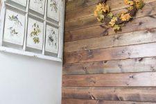 a simple bathroom fall decor with a wreath on a wall