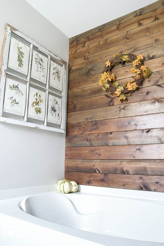 a mini gallery wall of vintage botanical posters, a vine and leaf wreath, a faux pumpkin is a gorgeous idea for the fall