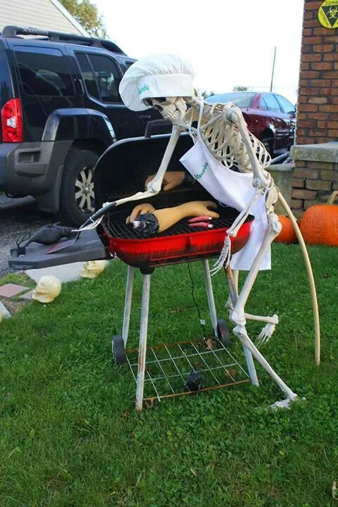 a mini outdoor Halloween scene of a skeleton grilling human body parts is a fun and scary idea for styling your outdoors