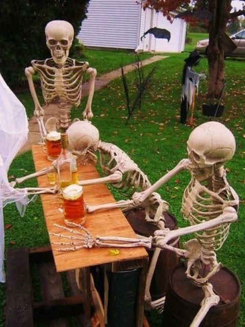 a mini outdoor Halloween scene with skeletons drinking beer is a fun idea for those who enjoy drinking it too