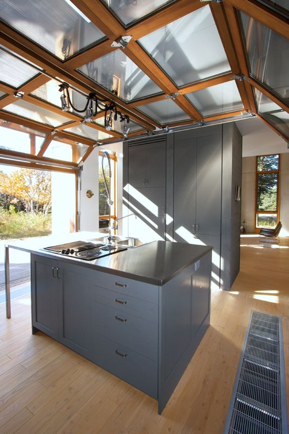 a modern kitchen with a roll up garage door to enjoy the views and fresh air and sunshine whole cooking and eating