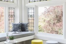 a cute modern living room with a windowsill nook
