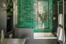 a moody green bathroom design