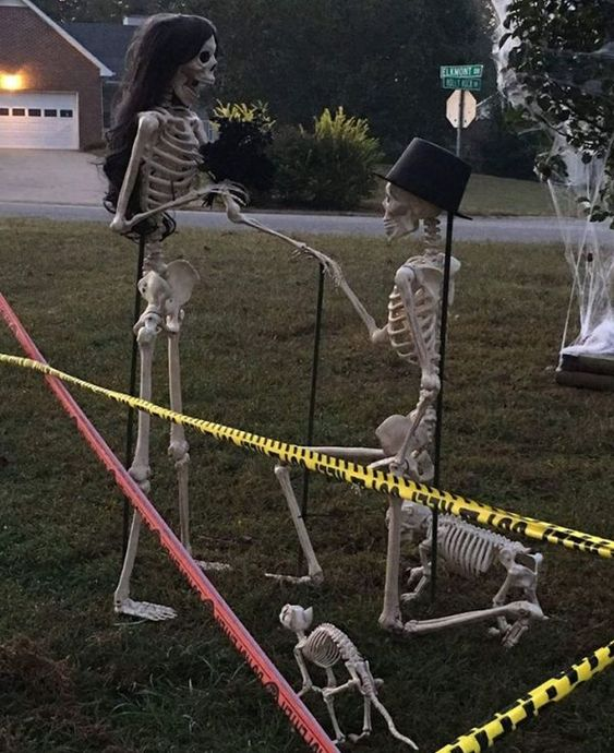 a romantic Halloween scene with skeletons proposing and some skeleton dogs is a very cool and lovely idea to rock