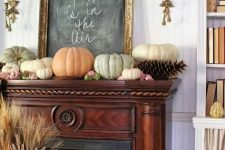 a rustic fall mantel with woodland touches – neutral and pastel heirloom pumpkins, giant pinecones and more pinecones next to the fireplace