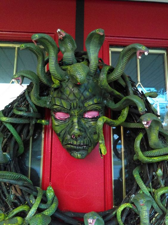 a scary medusa wreath with lots of snakes is a statement idea for Halloween front door decor