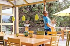 a simple and ann-natural dining space with light-stained dining set that can be opened up to outdoors with a garage door anytime