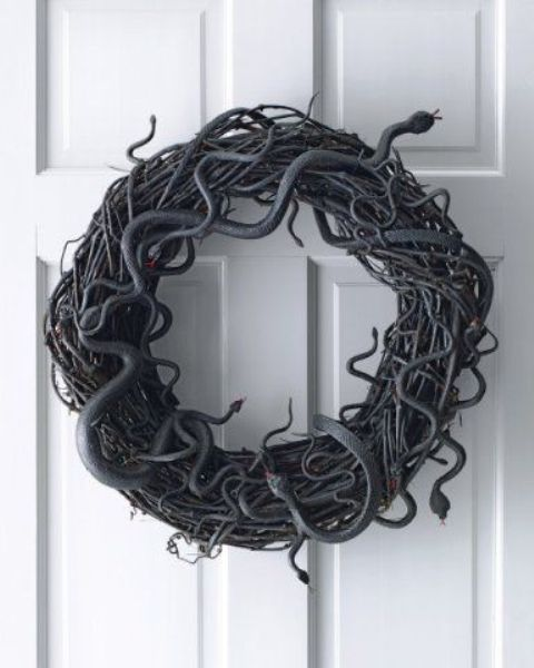 a simple black vine and snake Halloween wreath is a great last minute decoration as it doesn't require much effort or time