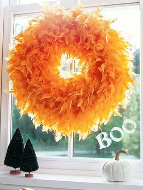a simple orange faux feather Halloween wreath is a gorgeous idea with plenty of color that isn't scary but stylish
