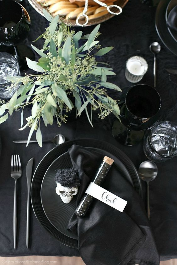 a simple seeded eucalyptus centerpiece will add life to your black tablescape and make it feel cooler