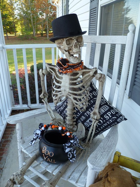 a skeleton in a top hat serving some sweets and candies in a cauldron is a cool idea for Halloween and creative decor