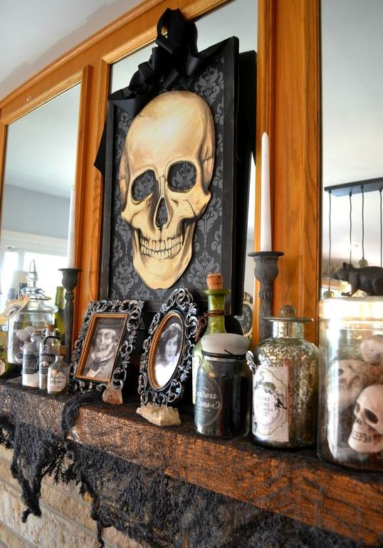 a skull artwork and some more skulls in a jar are amazing to style your Halloween mantel or a console table