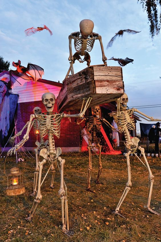 a spooky Halloween scene with skeletons carrying a coffin with another skeleton on top is a gorgeous idea to go for