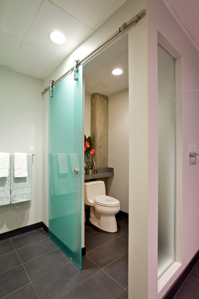 a turquoise frosted glass sliding door is a great idea for a powder room or to separate the toilet zone from the rest of the bathroom