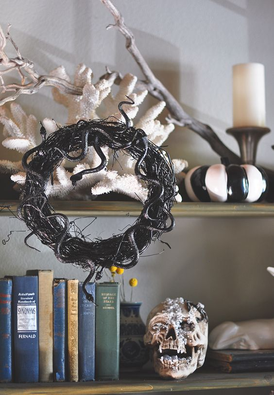 a vine and black snake Halloween wreath is a timeless and cool decoration for this spooky holiday
