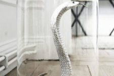 a white snake in a cloche is an elegant and scary Halloween decoration you can make yourself without much effort
