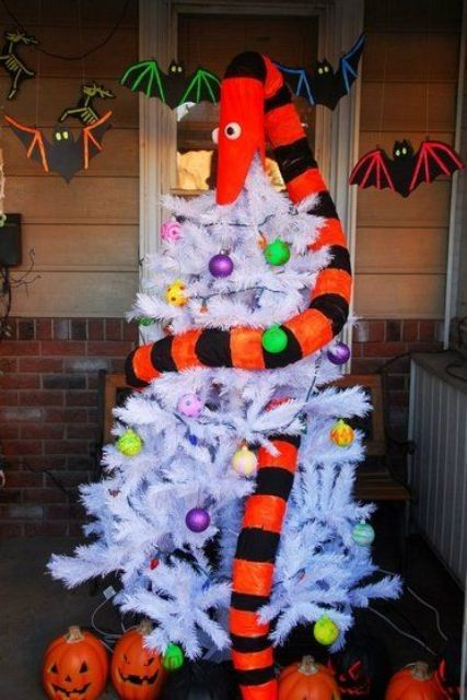 a white tree being eaten by the tree eating snake from Nightmare Before Christmas is a bold and cool idea