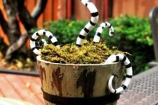 a wooden bucket with moss and black and white snakes from Nightmare Before Christmasfor Tim Burton fans
