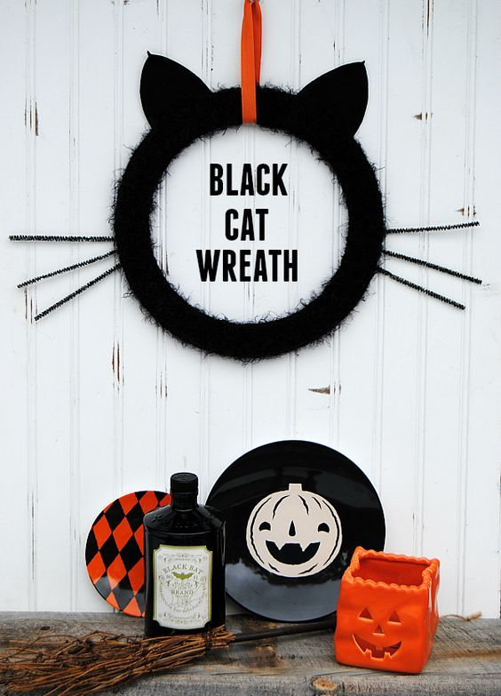 an easy and cute black cat wreath with cat ears and whiskers is a fun and lovely idea for Halloween