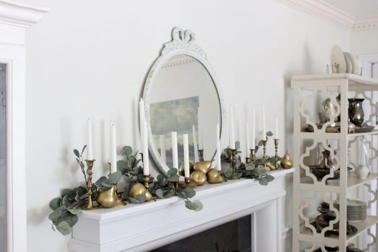 an eucalyptus garland is perfect to decorate a mantel for fall