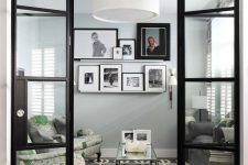 a modern gallery wall in a living room