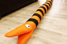 an orange and black striped Halloween decoration – a Nightmare Before Christmas tree eating snake