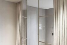 beige metal framing doors look ethereal and are covered with curtains for more privacy that glass doors usually don't give