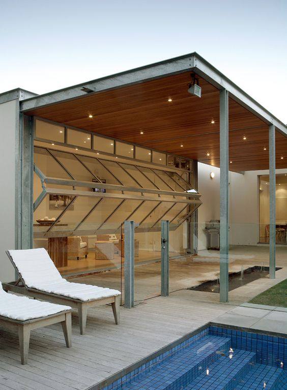 bi-fold garage doors open the living room to the outdoor spaces and provide outtdoor-indoor living at once