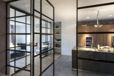black metal French doors throughout the house to interconnect the spaces but do it in a delicate and gentle way
