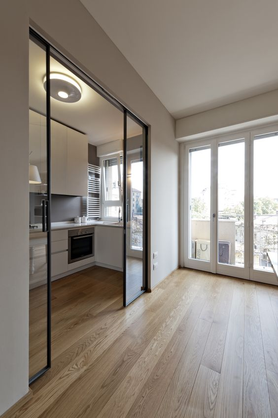 black metal framed pocket glass doors are perfect to separate any small nook without sacrificing the space for the doors