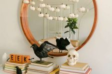 blackbirds, a skull, a garland with white pumpkins and some letters for modern and simple Halloween styling