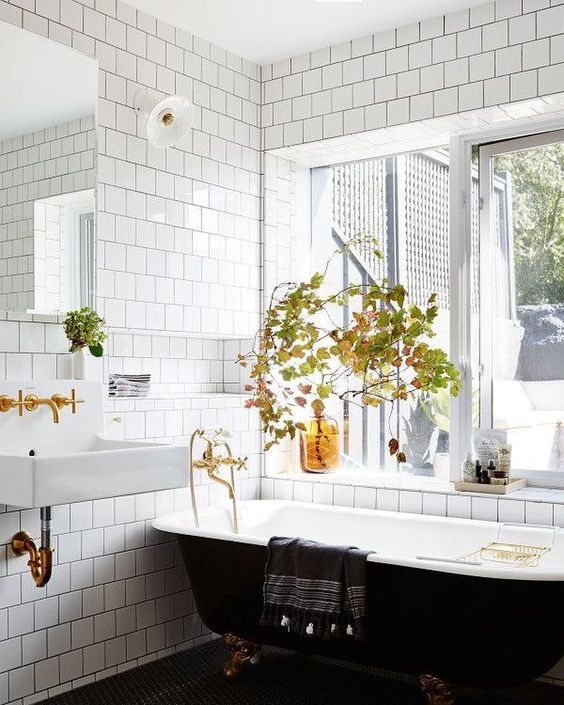 decorate your bathroom with fall leaf arrangements and some amber bottles - this is an easy way to embrace the season