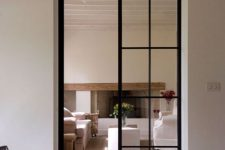 double-height narrow French glass doors are amazing to separate the spaces and make the light-filled at the same time