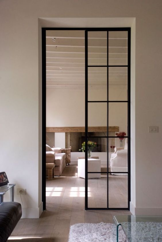 double height narrow French glass doors are amazing to separate the spaces and make the light filled at the same time