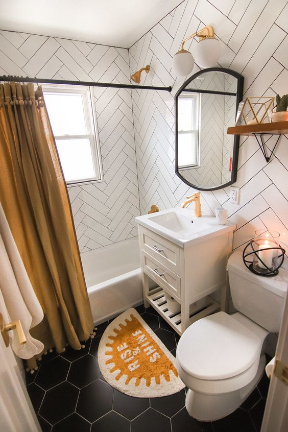easy fall bathroom styling with a mustard shower curtain with pompoms and a matchign mustard mini rug is a cool idea for any bathroom