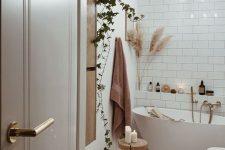 a cute bohemian bathroom decorated for fall