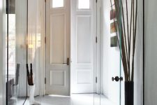 frameless glass doors are the best way to separate the spaces gently, it's a perfect solution for separating the entryway at once