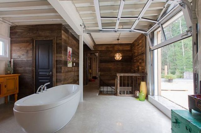 glass garage door opens the bathroom to outdoors perfectly, and you get views and fresh air, while your garden keeps you private here