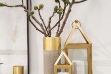 home decor done wiht brass candle lanterns, concrete and brass vases is amazing for decorating a contemporary or Scandinavian space