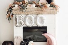 modern boho Halloween styling with heirloom and faux pumpkins, pampas grass, blooms, a half moon and a skull in neutral colors